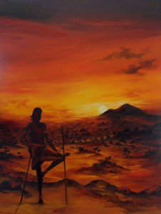 Massai warrior looking at the sun setting over his kingdom.